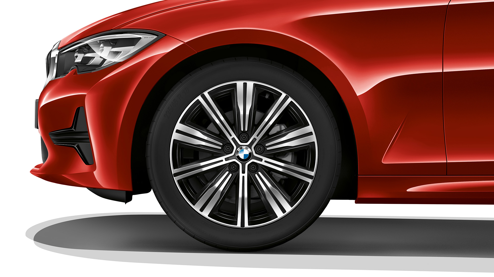 Close-up of the light alloy wheel of the BMW 3 Series Sedan with model Advantage features.