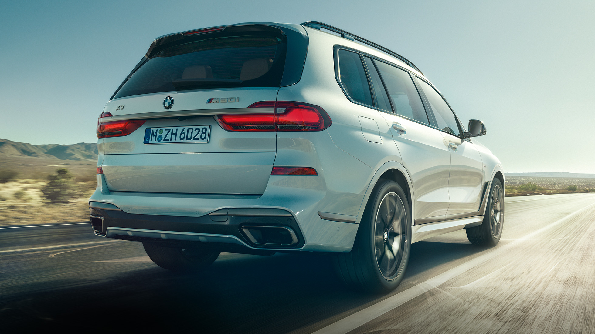 BMW X7 M50i in Mineral White, driving, rear view, G07, 2019